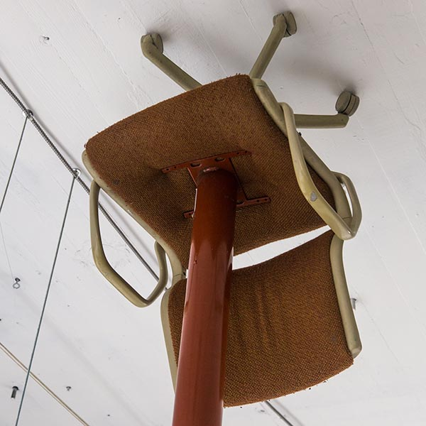 thumbnail link showing a sculpture of a chair upside down on a ceiling