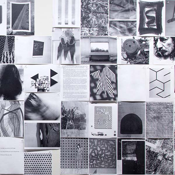 thumbnail link showing an collage of 8 by 11 inch print outs of black and white artworks on a gallery wall