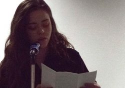 Sydney Rains reading poetry at Poetry 4 the People