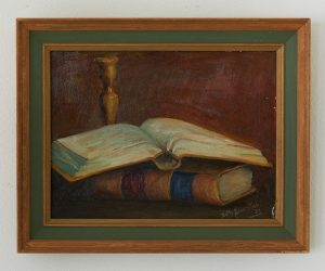 Oil painting of two books and a brass candle stick.