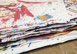 Image of paper splattered with paint.